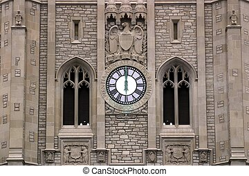 High Noon - Ancient clock tower with clock hands showing...
