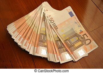 bunch of money - euros on wooden support