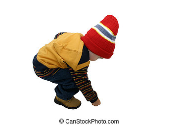 Boy w/Clipping Path - Toddler boy in winter clothes picking...