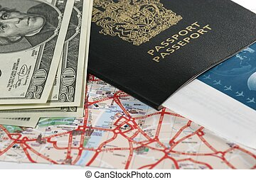 Travelling - Closeup of map, US dollar bills, passport and...