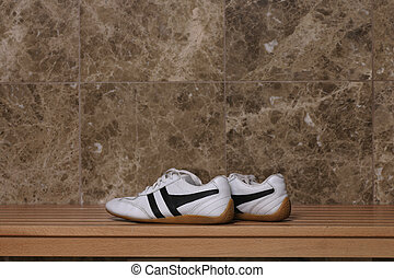 Sport shoes in locker room