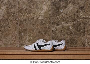 Sport shoes in locker room