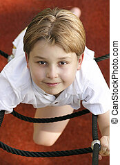 Ropes and ladders - Child on climbing aparatus (above view)