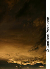 Sunset Background - Gold tones background of clouds at...