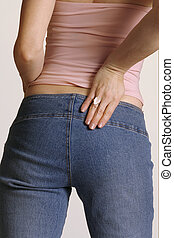 Shape up - Girl in jeans from behind
