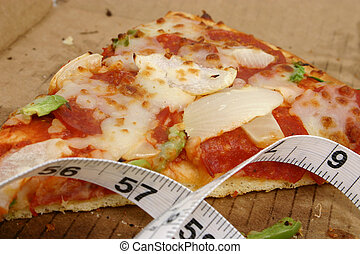 Pizza Diet 5 - Close up of a slice of pizza in a box near a...