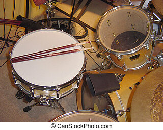 Drums - A set of percussion instruments used to set the...