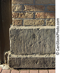 Cornerstone - The base of a brick wall on an historical...