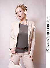 Beige beauty - Styled young woman in beige suit
