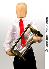Overtime - Photo of a Mannequin Holding an Hourglass.