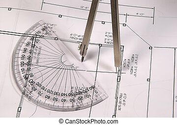 Compass - Photo of Plans and a Compass.