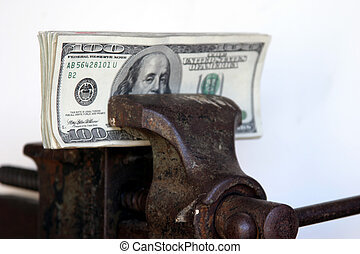 tight squeeze - american cash held tightly in a vice with a...