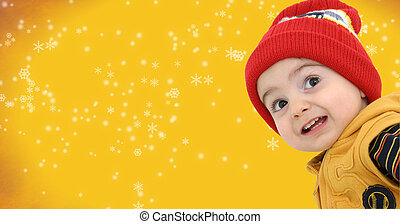 Boy w/Clipping Path - Happy boy against a yellow snowflake...