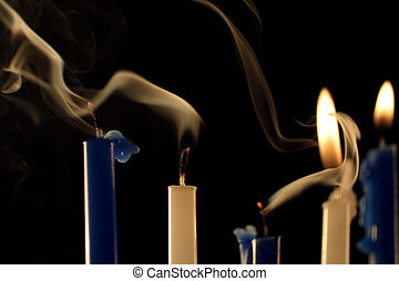 Smoke - five Hanukkah candles, two are still burning, and...