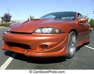 Orange Cavalier 1 - Fixed up orange Chevrolet Cavalier with...