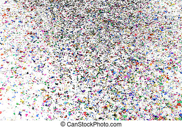 Confetti On the Floor - Pile of confetti on a white floor.
