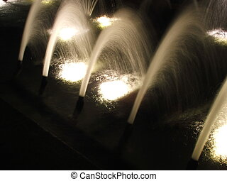 night fountains - many water jets brighly lit at night