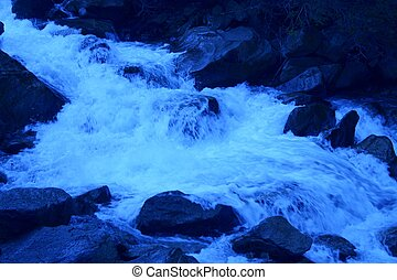 Blue Stream - Waters of fast moving stream rendered in...