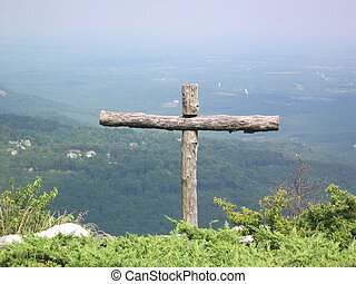 mountainside cross - a cross made of logs on a mountain side