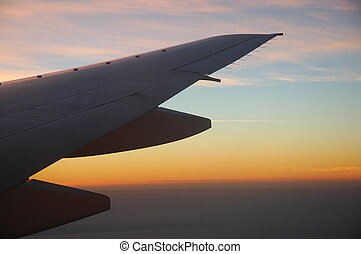 b777 wing at dawn - the end portion of boing 777 wing...