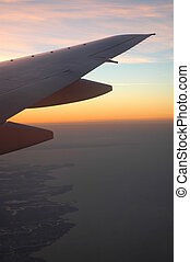 2B777 wing at dawn - boing 777 wing backlit by dawning sun.
