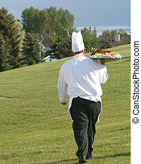 chef at golf course - chef with food tray at golf course