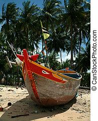 Fishing Boat - Vietnamese fishing boat sitting on the beach.