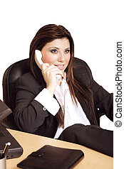 Managerial woman reclining on phone (isolated)