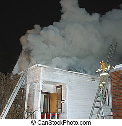 house fire - fireman on ladder at house fire