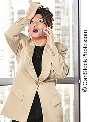 Doh - Businesswoman makes a gestuer while on the phone --...
