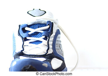 Athletic Shoe - A fairly hi-key isolated image of an...