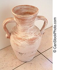 urn on tiles - pottery urn on terracotta tiles