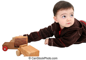 Boy Child Wooden Cars - Small boy playing with old wooden...