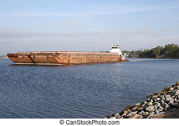 Tug n Barge1 - A tug transporting empty coal barges to be...