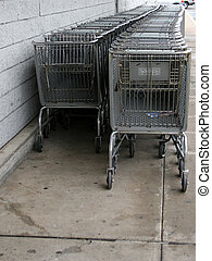 Shopping Carts - Row of grey shopping carts along a grey...