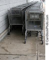 Shopping Carts - Row of grey shopping carts along a grey...