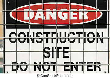 Construction warning sign - Warning sign on fence.