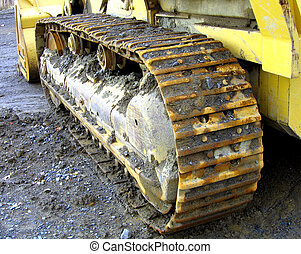 Big Tread - Muddy wheels on bulldozer
