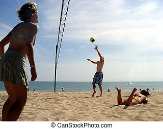 Beach Volleyball - Young people playing volleyball at the...