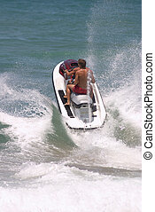 Jet-ski splash - A jet-ski carrying two people crashes...