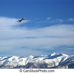 Plane Over Mountain - Plane Over Snowcapped Mountains. Taken...