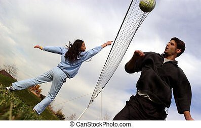 Family volleyball - A man and a girl playing volleyball