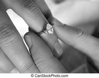 Engagement Ring - This is a ring being put on a girls finger...