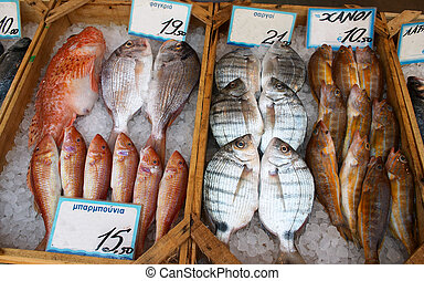 Greek fishmonger\'s - Display on a Greek fishmonger\'s slab.