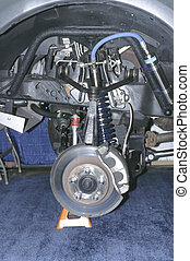 Front Assembly - front wheel brake and suspension assembly...