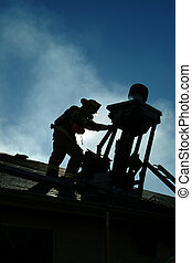 Firemans Silhouette - Silhouete of fire fighter on top of...