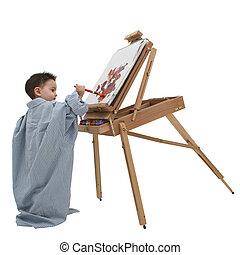 Boy Painting - Small boy in dad's shirt painting at a wooden...