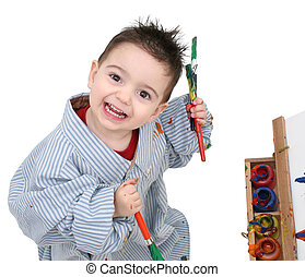 Boy Painting - Small boy in dads shirt painting at a wooden...