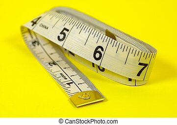 Tape Measure - Tape MEasure on Yellow Background