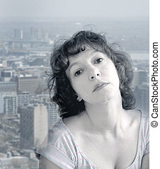 daydreaming - Attractive woman daydreaming against the...